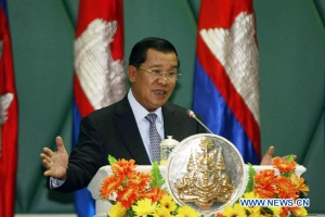 Cambodian Prime Minister Hun Sen speaks during the inauguration of the National Council on Green Growth in Phnom Penh, Cambodia, March 19, 2013. Hun Sen on Tuesday appealed to citizens to cast their ballots for his ruling party in the general election slated for July 28. (Xinhua/Sovannara)